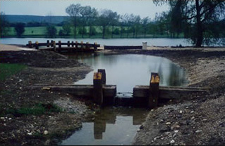 Construction of a small bridge and a wooden flow meter